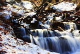 Spring and mountains. Bučací waterfall, snow, thaw and high water. Beskydy.