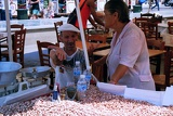 Summer. City of Athens. Square, market, old salesman and saleswoman. Greece.