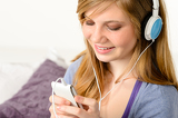 Fresh adolescent girl listening to music