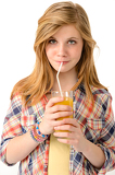 Fotografie Pretty girl drinking juice with straw