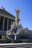 Town. Parliament, the statue of the goddess Pallas Athena and the fountain. Vienna - Austria.