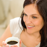 Close up woman holding cup of coffee