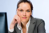 Calm confident businesswoman looking at camera