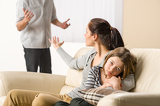 Fotografia Arguing parents with upset little girl