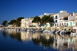 Photo Sea. Harbor, boats, docks, pier and houses. Island of Mallorca - Portocolom.
