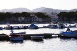 Summer, sea and mountains. Harbor, boats, docks, pier and houses. Island of Mallorca - Portocolom.