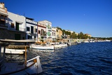 Summer and sea. Harbor, boats, docks, pier and houses. Island of Mallorca - Portocolom.