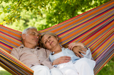 Fotografia Senior couple relax sleeping in hammock