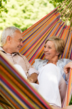 Happy elderly couple in hammock