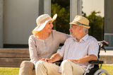Fotografia Senior disabled man and wife talking outdoors