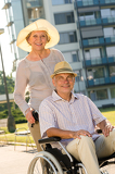 Fotografie Wealthy senior man in wheelchair with wife