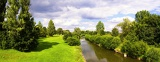 Fotografie Summer. Odra river, clouds, landscape, meadows and trees.
