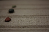 Fotografia Zen Garden - three hirozontally composed stones on sand i