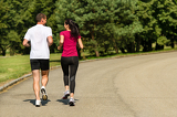 Rear view of jogging caucasian couple