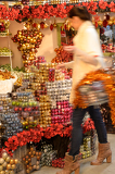 Blurry woman buyer shopping Christmas decorations