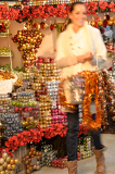 Smiling woman buying Christmas ornaments in shop