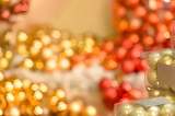 Blurred sparkling red and golden Christmas bulbs