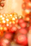 Christmas bulbs glittering background red and gold