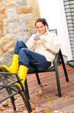 Fotografie Cheerful woman enjoy tea relaxing veranda autumn