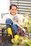 Fotografie Happy woman relaxing cup tea sitting backyard