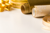 Gold wrapping paper and bow Christmas decoration