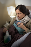 Sick woman with flu, tissue and tea