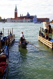 City of Venice. Harbour, gondola, Man and the Sea. Italy.
