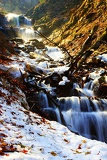 Fotografie Fall and mountains. Waterfall, leaves and snow. Beskydy.