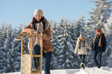 Fotografie Young woman sunny winter lean against sledge