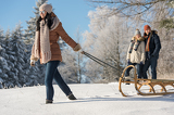 Fotografie Young woman pulling winter sledge snow countryside