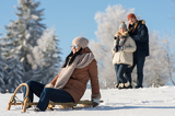 Fotografie Friends enjoy sunny winter day on sledge