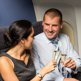 Fotografie Flight cabin business partners toasting champagne