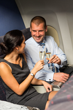 Fotografie Smart couple travel by airplane toasting champagne