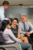 Fotografie Business people passengers flying airplane talking