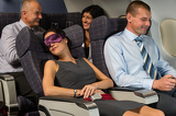 Fotografie Business woman sleep during flight airplane cabin