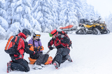 Fotografie Ski patrol team rescue woman broken arm