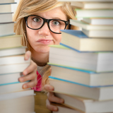 Desperate student teenager look from behind books