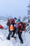 Ski patrol carry injured woman skier stretcher