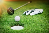 Fotografie golf equipment on green grass