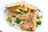 lightly fried salmon with herb sauce with broccoli and baked baguettes