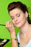 Fotografie young happy beautiful woman with makeup brush