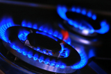Fotografia blue flames of gas stove