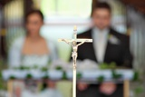the groom and bride at the wedding ceremony in church  soft focus
