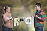 Fotografie woman and husband holding the string on which are the clothes and ultrasound photo their future baby