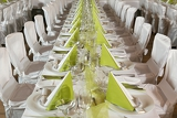Photo look at the tables prepared for the celebration in a restaurant