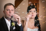 the bride and groom to blow a bubble blower