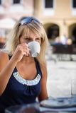 Fotografie young woman  sipping coffee from a cup