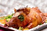 decorated and roast pig on a platter
