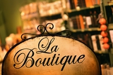 board at the store in antique style with the word boutique