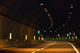 abstract speed motion in urban highway road tunnel blurred motion toward the central shot from a slow moving car